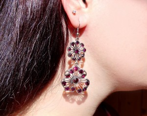 earrings jewellery with bright crystals in ear