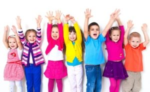 17849115 - large group of children happily pulled his hands up in  white wall